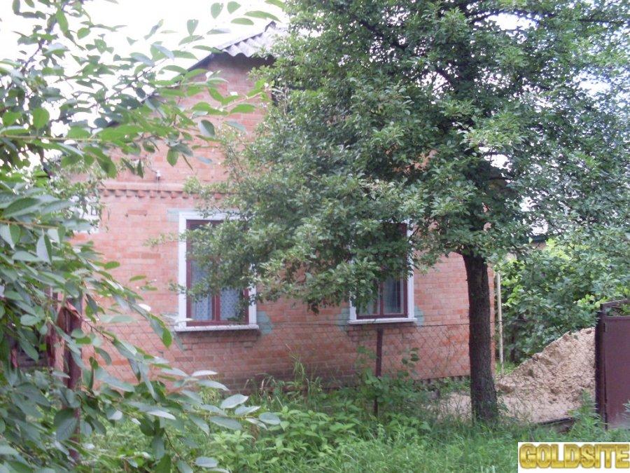 Дом в Полтаве на участке 7 соток.   Летняя кухня,   мастерская.  Все удобства.