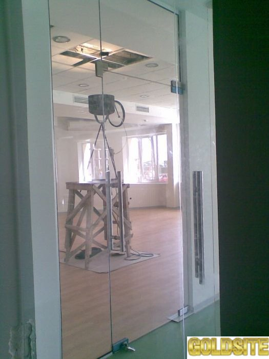 маятниковые стеклянные двери киев,   двери из закаленного стекла киев